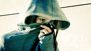 stylized photo of a woman hiding her face