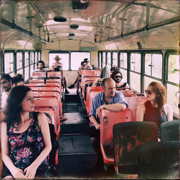 photo of a group of people sitting on a bus