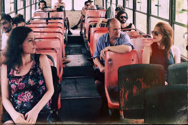 photo of Professor Hoffman riding a bus with students in Cuba