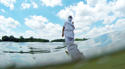 photo of a man wading in water