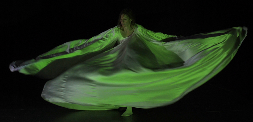 photo of a woman dancing.