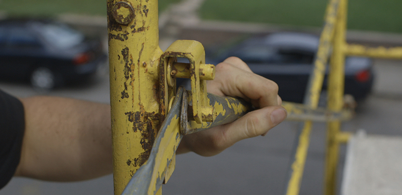 photo of a hand holding a scaffold brace.