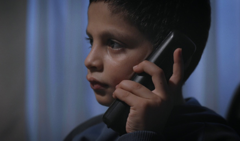 photo of a boy talking on a cell phone