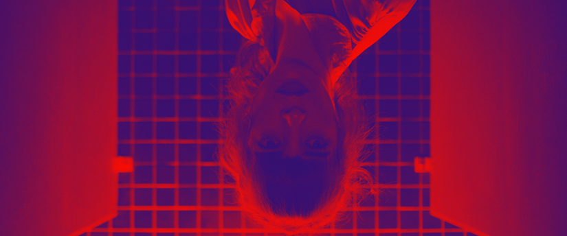 inverted and stylized photo of a woman in a washroom stall