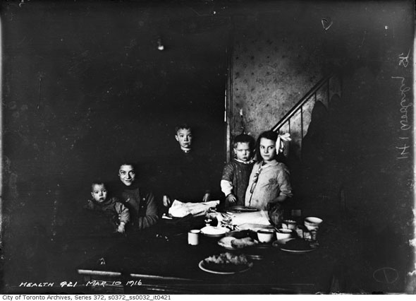 black and white archive photo dated 1916 showing a poor family in Toronto from the Toronto Archives